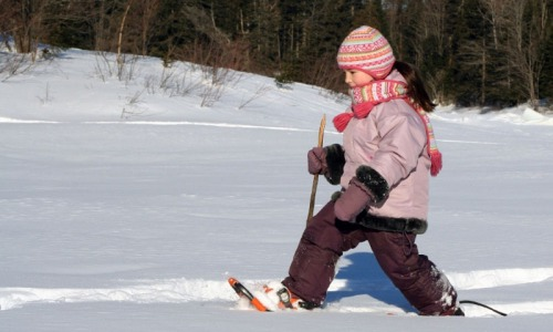 girl-snowshoeing-winter-horns-ferry-hideaway